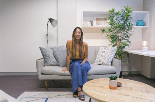 Mary Hoang founder of The Indigo Project sits in the psychology practice couch in Surry Hills