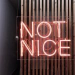 "Red neon sign saying ""not nice"""